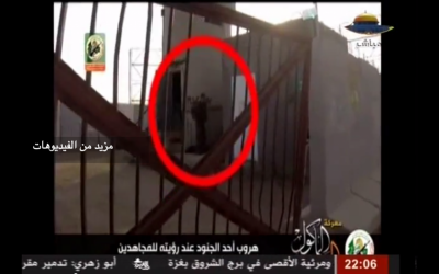 A screenshot from the video showing Hamas gunmen infiltrating an IDF base inside Israel near Kibbutz Nahal Oz, July 28, 2014. (YouTube: screenshot)