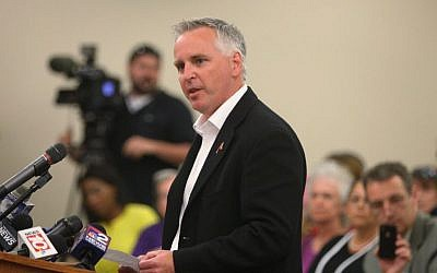 Dan Courtney, of Hamlin, N.Y., and an atheist, delivers the invocation at the Greece, N.Y., town board meeting, Tuesday July 15, 2014. The community's leaders won a U.S. Supreme Court decision upholding the right to start such gatherings with a prayer. (AP Photo/Democrat & Chronicle, Jamie Germano)