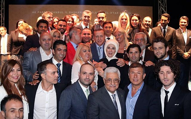 Turkey's Prime Minister Recep Tayyip Erdogan, center in third row, and Palestinian Authority President Mahmoud Abbas, front center, with Turkish artists who joined them in a show of support for the Palestinian people, in Istanbul, Turkey, Friday, July 18, 2014. (photo credit: AP Photo/Kayhan Ozer, Turkish Prime Minister's Press Office, HO)