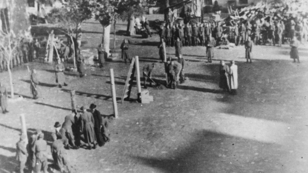 This photo provided by United States Holocaust Memorial Museum shows Hungarian occupation troops in Novi Sad, Yugoslavia, Nov 25, 1941, prepare the gallows for the public execution of members of the People's Liberation Resistance. A largely unknown archive documenting thousands of cases against World War II criminals, from Hitler to many average participants in the Holocaust who were never brought to trial, are being made public and unrestricted for the first time at the U.S. Holocaust Memorial Museum in Washington after being locked away for decades at the United Nations. (AP Photo/Muzej Revolucije Narodnosti Jugoslavije via United States Holocaust Memorial Museum)