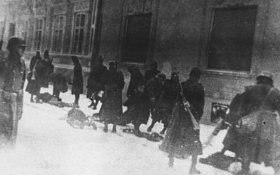 This photo provided by United States Holocaust Memorial Museum shows Hungarian soldiers as they execute Serbians and Jews on Miletic Street in Novi Sad, Yugoslavia, January 23, 1942. (AP Photo/Jewish Historical Museum, Belgrade via United States Holocaust Memorial Museum)