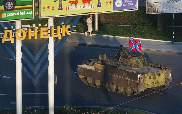 A Donetsk People's Republic APC moves through the city of Donetsk, eastern Ukraine Sunday, July 27, 2014. (photo credit: AP/Dmitry Lovetsky)