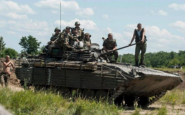 Ukrainian troops atop an APC at a checkpoint near Slovyansk, eastern Ukraine, Saturday, July 5, 2014. (AP Photo/Evgeniy Maloletka)