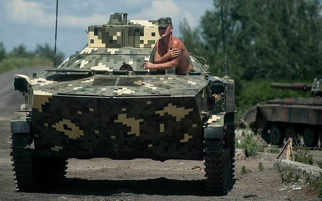 A Ukrainian paratrooper sits in an APC at a checkpoint near Slovyansk, eastern Ukraine, Saturday, July 5, 2014. (AP Photo/Evgeniy Maloletka)