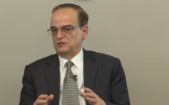 Hadi al-Bahra speaks during a public discussion March 18, 2014, following the Geneva II peace conference. (screen capture: YouTube/US Institute of Peace)
