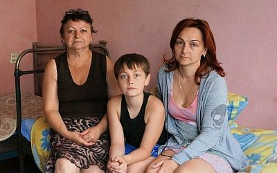 Ludmila Lazaurenko, right, with her son Anatoly and mother Nadezhda Belovol at their temporary housing near Dnepropetrovsk, Ukraine, July 14, 2014.  (Cnaan Liphshiz/JTA)