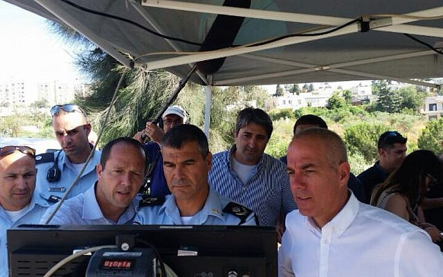 Jerusalem Mayor Nir Barkat (second from left), Chief of Jerusalem Police Yohanan Danino, and Jerusalem  Municipality CEO Amnon Merchav (in white shirt) at the controls of a Bladeworx UAV (photo credit: Courtesy)