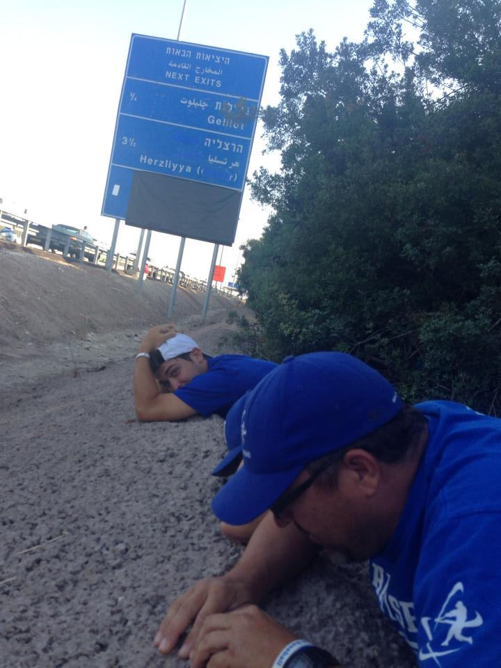 Members of Israel's national baseball team takes cover on Ayalon highway (photo credit: Courtesy/Nate fish/IAB)