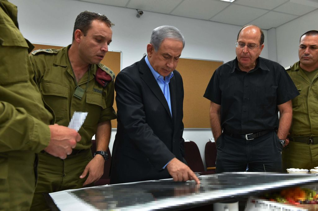Prime Minister Benjamin Netanyahu and Defense Minister Moshe Yaalon consult at the IDF's Southern Command (photo credit: Ariel Hermoni/Defense Ministry)