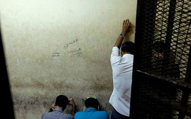 Illustrative photo: Egyptian men attend their trial at a court in Cairo, Egypt, Wednesday, July 16, 2014 (AP/Aly Hazzaa, El Shorouk)