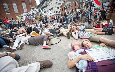 Pro-Palestinian activists staged a 'die-in' against Israel on the Boston Common yesterday (photo credit: Elan Kawesch/The Times of Israel)