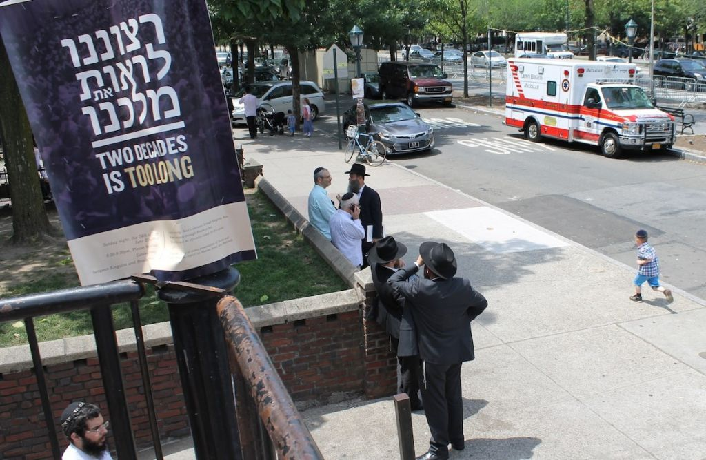 "A placard outside a Chabad yeshiva in Crown Heights adjacent to the Lubavitcher rebbe's onetime office in Brooklyn is a sign of the messianism that still pervades the movement. ""It is our will to see our king,"" the placard says in Hebrew, and then in English,""Two decades is too long,"" June 30, 2014. (photo credit: Uriel Heilman/JTA)"
