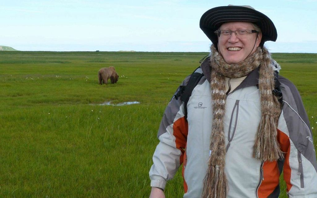 Donn Ungar, who is making aliyah, posing in in Alaska with a grizzly bear in the background. (photo credit: Donn Ungar)