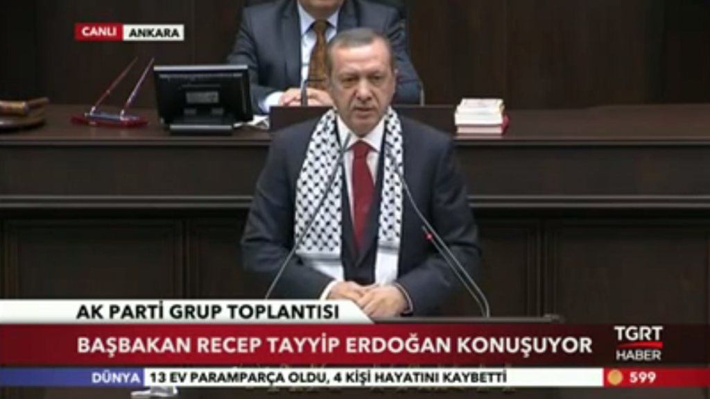Turkish Prime Minister Recep Tayyip Erdogan weara a keffiyeh during a July 22, 2014 AKP party meeting as a show of solidarity with the Palestinian people (photo credit: AFP/Adem Altan)