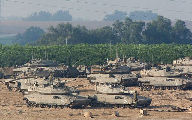 Israeli tanks seen near the Gaza border in southern Israel, on the second day of Operation Protective Edge, July 9, 2014. (photo credit: Yonatan Sindel/Flash90)