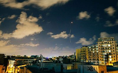 An Iron Dome interceptor rocket flies above the Tel Aviv skyline (photo credit: Matanya Tausig/Flash 90)