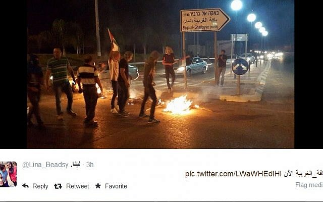 Rioting in Baqa al-Gharbiya. (screen capture, Twitter)