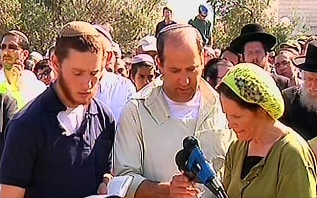 The Fraenkel family reciting kaddish at the funeral for their son Naftali on Tuesday. (Screen credit: Channel 2)