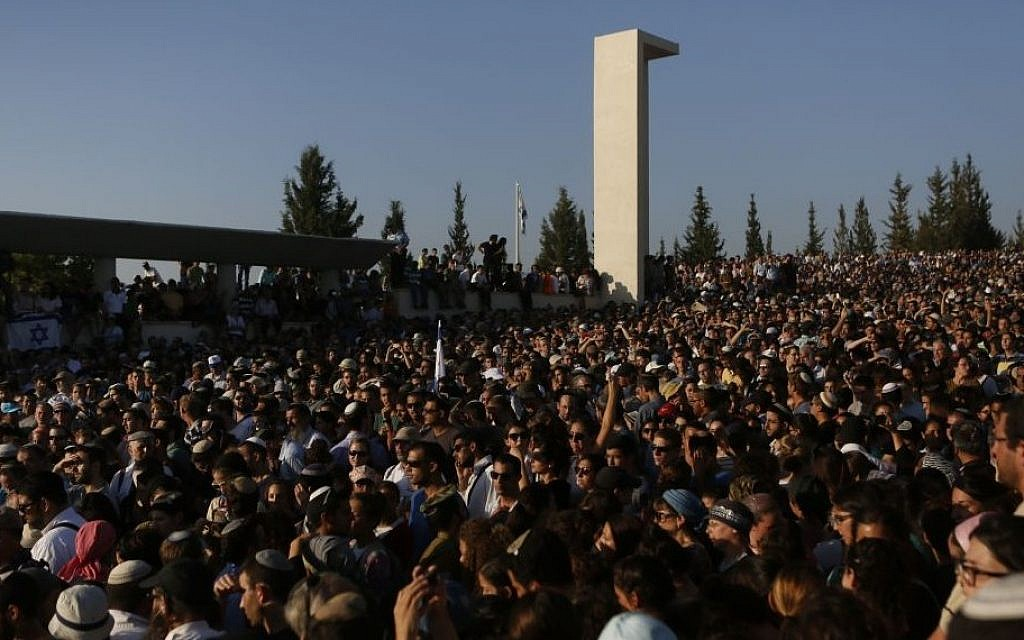 Thousands of people attend the joint funeral for the three murdered Jewish teens, in the Modiin cemetery, on July 1, 2014 (photo credit: Miriam Alster/Flash90)