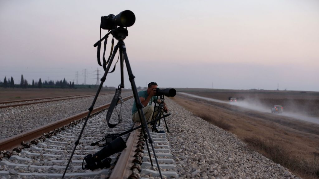 Illustrative: An Israeli press photographer documenting the movement of IDF forces near the border with Gaza, in southern Israel, on July 23, 2014. (photo credit: Nati Shohat/Flash90)