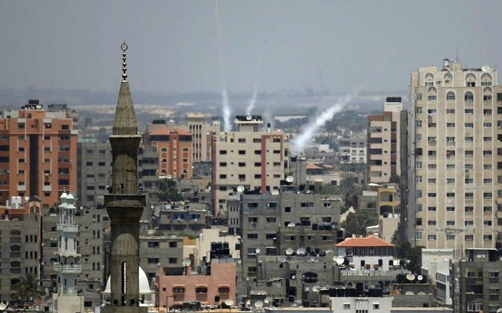 Smoke from rockets fired from Gaza City is seen after being launched toward Israel, on July 15, 2014 ( photo credit: AFP/ Thomas Coex)