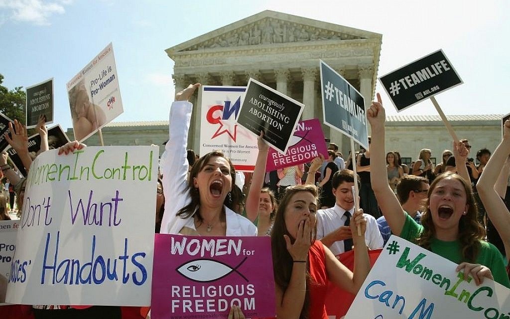 Demonstrators in Washington celebrate the US Supreme Court decision in the Hobby Lobby case, June 30, 2014. (Mark Wilson/Getty Images/via JTA)