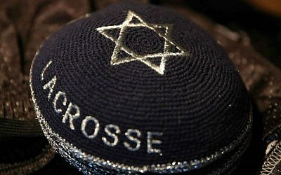 A stack of traditional Jewish skullcaps bear the words 'Israel Lacrosse,' part of the Israeli Lacrosse team's gear, Commerce City, Colorado,  July 15, 2014. (photo credit: AP/Brennan Linsley)