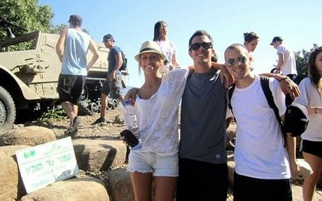 In this June 2012 photo courtesy of Stuart Steinberg, Max Steinberg, right, poses while on a trip to Israel with his siblings Paige Steinberg, left, and Jake Steinberg.  (photo credit: AP Photo/Courtesy of Stuart Steinberg)