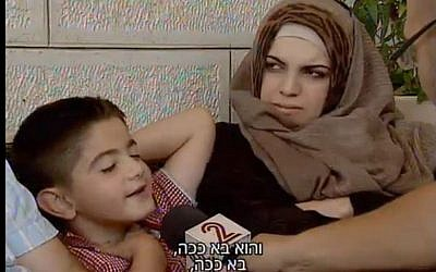 9-year-old Musa Zalum, who was nearly kidnapped by Muhammad Abu Khdeir's murderers the day before, reenacts the event (screen capture: Channel 2)