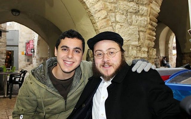 This 2012 photo provided by Rabbi Asher Hecht, shows Nissim Sean Carmeli, left, with Hecht in Jerusalem. (photo credit: AP Photo/Rabbi Asher Hecht via Chabad of the Rio Grande Valley)