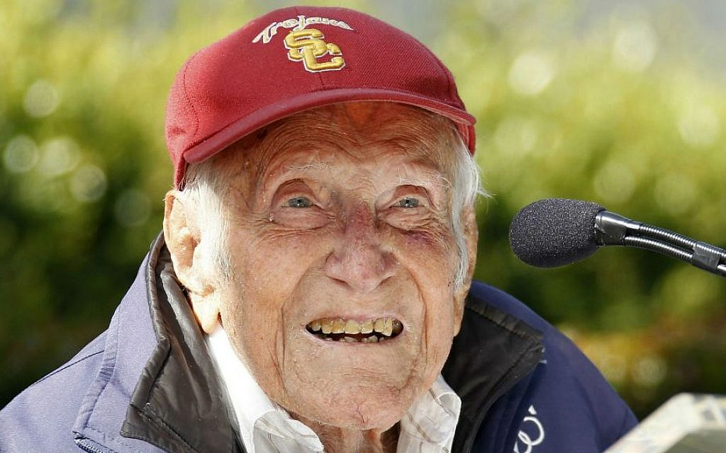 US Olympic distance runner and World War II veteran Louis Zamperini gestures during a news conference, in Pasadena, Calif. Zamperini, May 9, 2014. (photo credit: AP/Nick Ut)