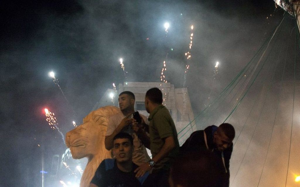 Palestinians launch fireworks during celebrations in the West bank city of Ramallah, late Sunday, July 20, 2014. (photo credit: AP Photo/Nasser Nasser)