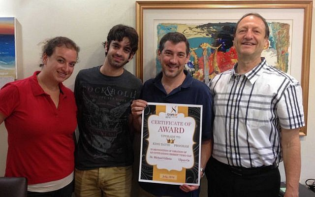 Michael Gillette (second from right) receives certificate of achievement from Ulpan-Or staff Gavi Lewy-Neuman (left), Dor Yerushalmi and Yoel Ganor. (Photo credit: Renee Ghert-Zand)
