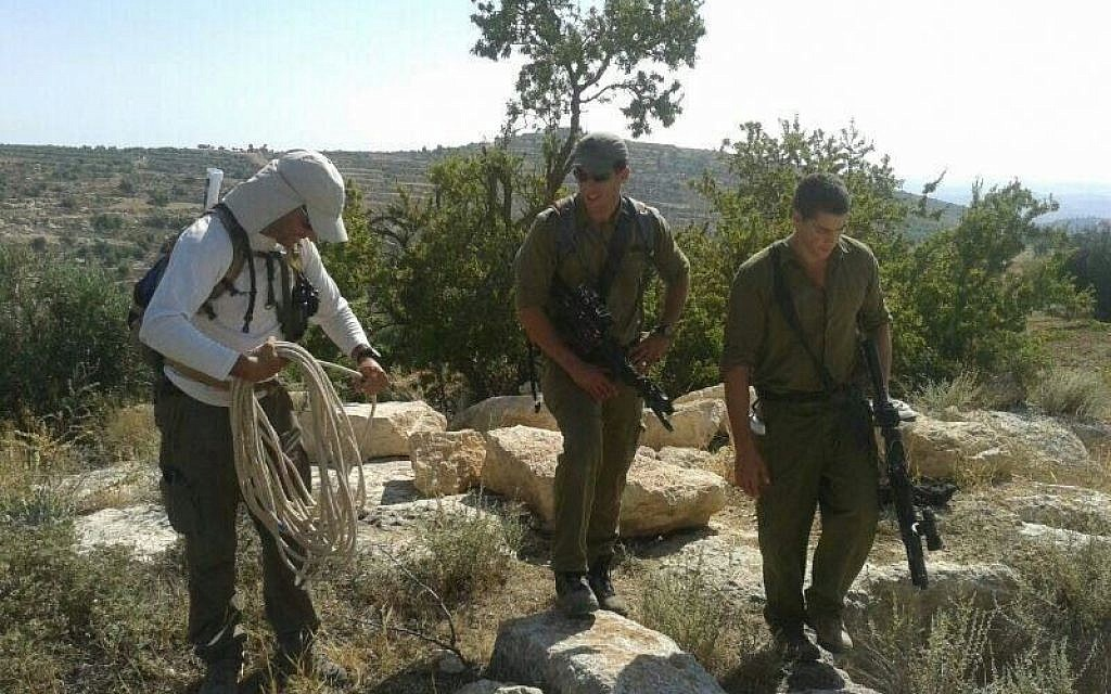 Hovav Landau, left, along with two soldiers in the Halhul region Monday (photo credit: Binyamin Tropper/ courtesy)