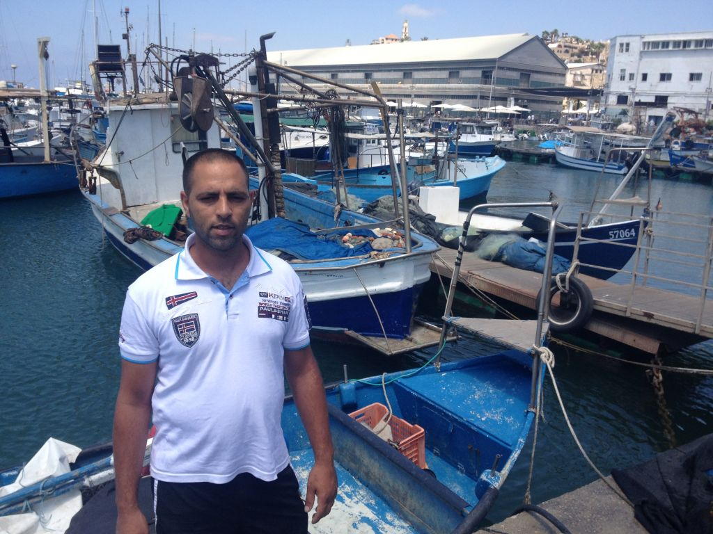 Dudu Sahifi is frustrated by empty nets and a lack of access to his regular customers in Gaza (photo credit: Jessica Steinberg/Times of Israel)