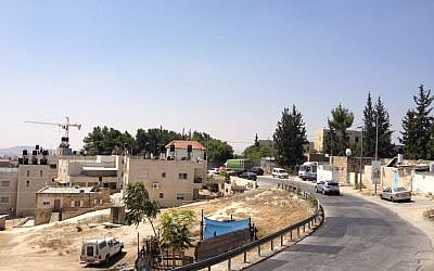 A main street in Jabel Mukaber, one of the Arab villages abutting Armon Hanatziv (Jessica Steinberg/Times of Israel)