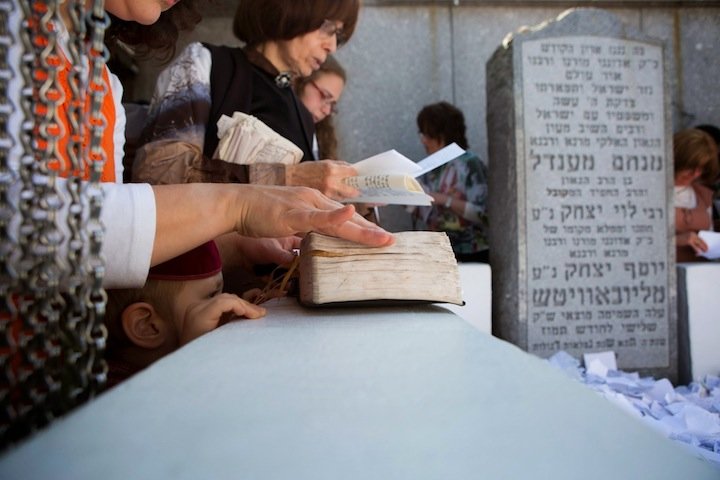 Women pray at the gravesite of the late Lubavitcher rebbe, Menachem Mendel Schneerson, on the 20th anniversary of his death, in Queens, New York, July 1, 2014. (photo credit: Adam Ben Cohen/Chabad.org)