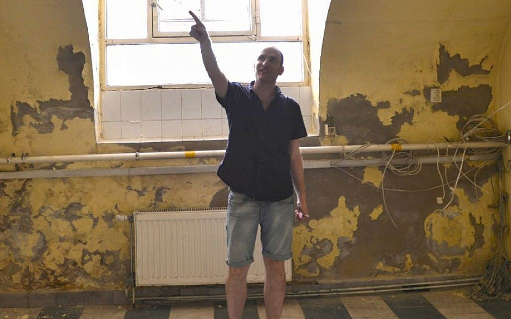 Adam Schoenberger at the new Budapest headquarters of Marom, the cultural organization he helped found. (Cnaan Liphshiz/JTA)