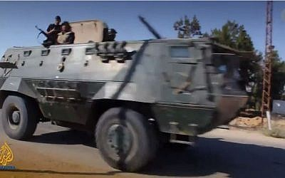 Egyptian armored vehicle in the Sinai Peninsula. (screen capture: YouTube/Al Jazeera English)