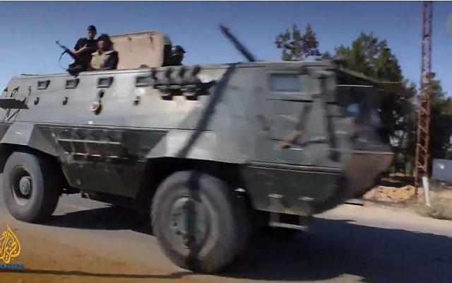 Egyptian armored vehicle in the Sinai Peninsula. (screen capture: YouTube/Al Jazeera English)
