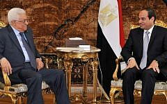 Egypt's President Abdel-Fattah el-Sissi (right) meets with Palestinian Authority President Mahmoud Abbas (left) in Cairo, Egypt, on July 17, 2014. (photo credit: AFP/HO/Egyptian Presidency)