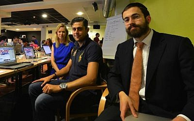 Rabbi Yanki Jacobs, right, with Christian volunteers Timo Erkelens and Eveline Hagoort in the pro-Israel situation room near Amsterdam, July 24, 2014. (Cnaan Liphshiz/JTA)