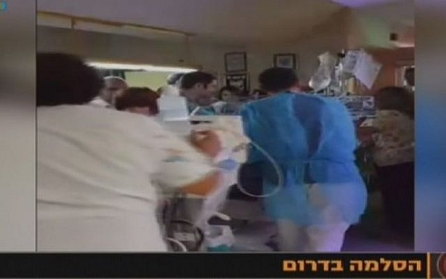 Medical personnel in the Soroka Medical Center in Beersheba move premature babies to protected rooms (screen capture: Channel 10)