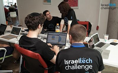 Tech Challenge participants working on a project (Photo credit: Courtesy)