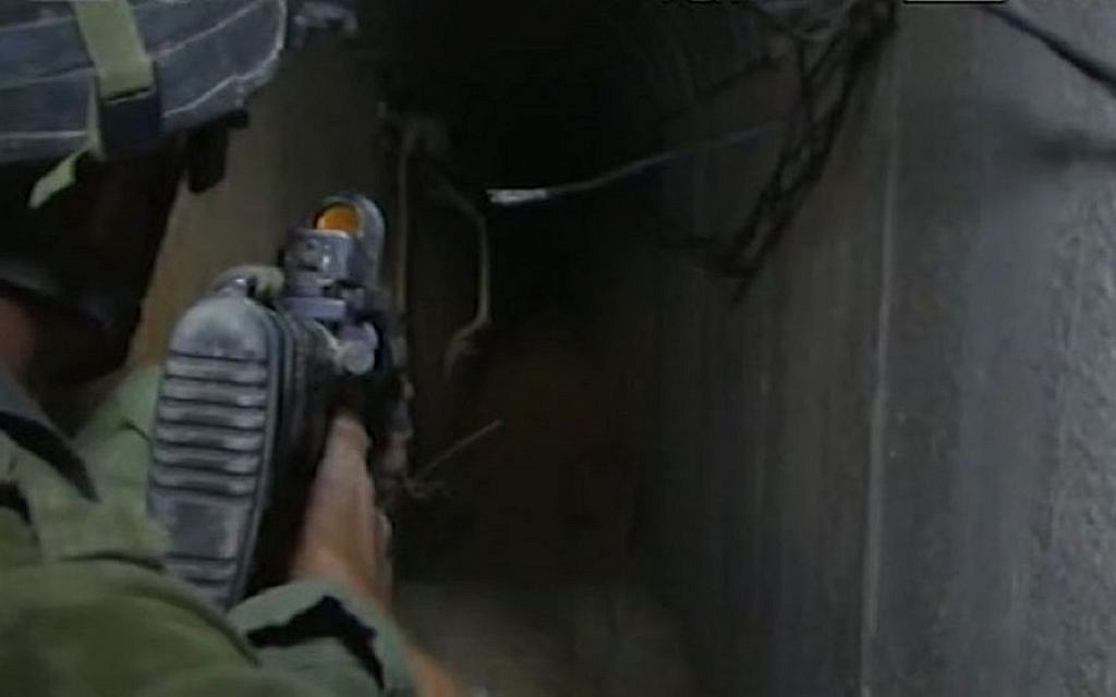 A soldier leading journalists through a tunnel in Khan Yunis (screen capture: Walla! News)