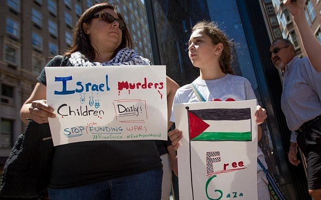 Zeina Othman, whose family is from Jerusalem, protests against Israel with her daughter outside the Israeli consulate on Friday (photo credit: Elan Kawesch/The Times of Israel)