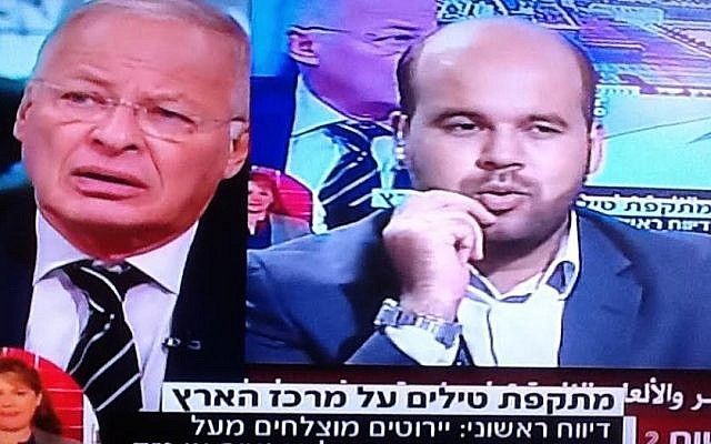 Channel 2's Ehud Yaari left) speaks to Hamas's Al-Aksa TV presenter, live on both stations (Channel 2 screenshot)