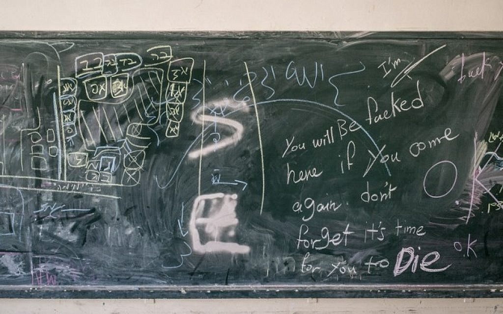 Some military instructions in Hebrew and a map of a school are seen on a blackboard after Israeli soldiers withdrew from the Beit Hanun High school for girls Tuesday, on August 5, 2014. (photo credit: Marco Longari/AFP)