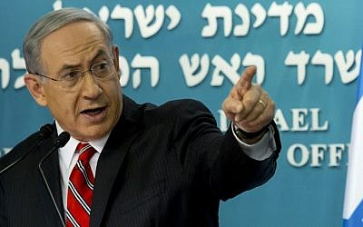 Prime Minister Benjamin Netanyahu gestures during a press conference at his Jerusalem offices, on Wednesday, August 6, 2014 (photo credit: AFP/JIM HOLLANDER/POOL)