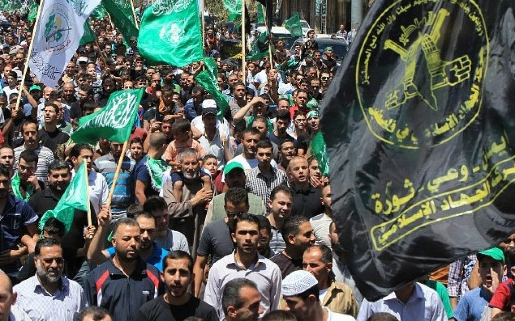 Illustrative photo of Palestinian protesters waving Hamas and Islamic Jihad flags as they take part in a demonstration is support of Gaza in the West Bank (AFP/HAZEM BADER)
